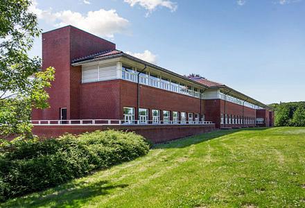 Region Syddanmark har masser af bygger på vej. Her Sygeplejeskolen i Vejle, der skal ombygges til politiskole. (Foto: Colliers International Danmark)